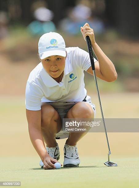 Amateur Minjee Lee of Australia lines up a puytt on the first green during the third round of the 69th US Women's Open at Pinehurst Resort Country...
