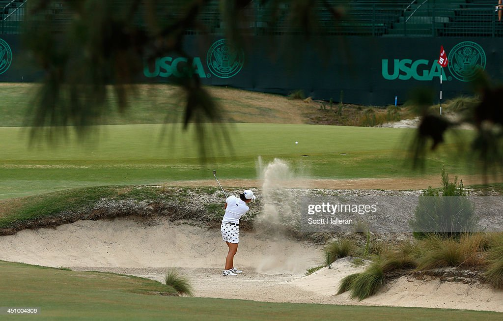Amateur Minjee Lee of Australia plays a bunker shot on the 16th hole during the third round of the 69th U.S. Women's Open at Pinehurst Resort & Country Club, Course No. 2 on June 21, 2014 in Pinehurst, North Carolina.