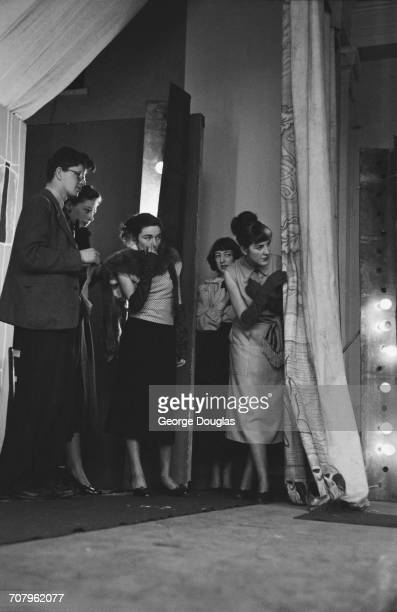 Amateur models wait to go on stage stage at a student fashion show for charity held at the Glasgow School of Art July 1952 From second left Nan...