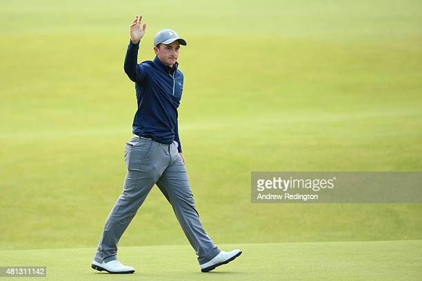 Amateur Paul Dunne of Ireland waves to the crowd on the 18th green during the third round of the 144th Open Championship at The Old Course on July 19...