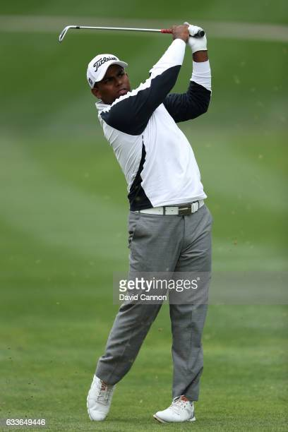 Amateur Rayhan Thomas of India hits his second shot on the 1st hole during the second round of the Omega Dubai Desert Classic at Emirates Golf Club...