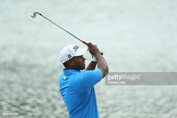 Amateur Rayhan Thomas of India plays his second shot into the ninth green during the first round of the Omega Dubai Desert Classic at Emirates Golf...