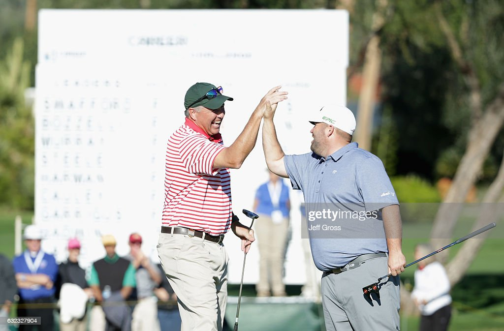Amateur Rob Mueller reacts to his birdie on the 18th hole and is congratulated by Colt Knost during the third round of the CareerBuilder Challenge in Partnership with The Clinton Foundation at La Quinta Country Club on January 21, 2017 in La Quinta, California.
