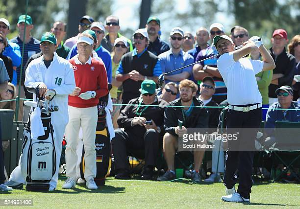 Amateur Romain Langasque of France hits a shot as Bernhard Langer looks on during the second round of the 2016 Masters Tournament at the Augusta...