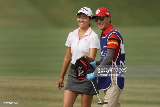 Amateur Rose Zhang of the United States reacts with her caddie after an eagle on the fourth hole during the third round of the ANA Inspiration on the...