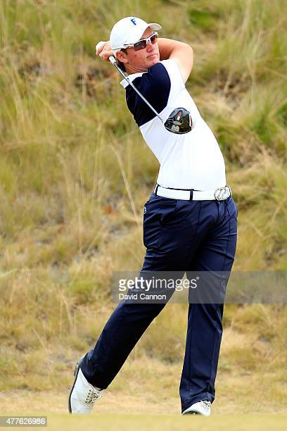 Amateur Sam Horsfield of England hits his tee shot on the sixth hole during the first round of the 115th US Open Championship at Chambers Bay on June...