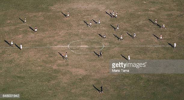 Amateur soccer players practice on a field on July 4 2016 in Rio de Janeiro Brazil July 5 marks the onemonth mark to the beginning of the Rio 2016...