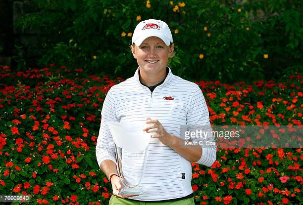 Amateur Stacy Lewis poses with the trophy after she was declared the leader following the first round of the 2007 LPGA NW Arkansas Championship...