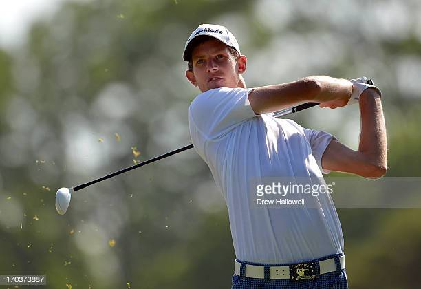 Amateur Steven Fox of the United States hits a tee shot during a practice round prior to the start of the 113th U.S. Open at Merion Golf Club on June...