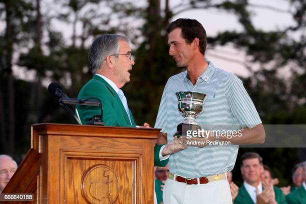 Amateur Stewart Hagestad of the United States is presented with the LowAmateur trophy by Chairman of Augusta National Golf Club William Porter Payne...