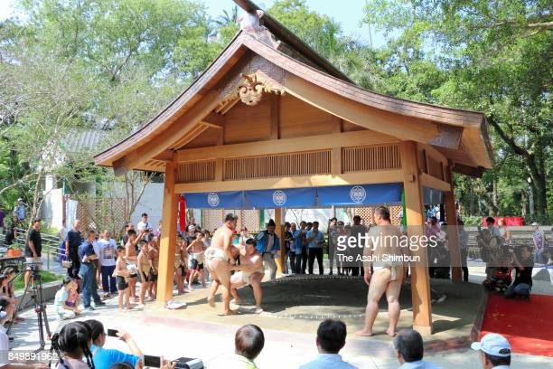 Amateur sumo wrestlers fight on a recently completed dohyo in a park on September 17 2017 in Taoyuan Taiwan A ceremony was held for the revival of a...