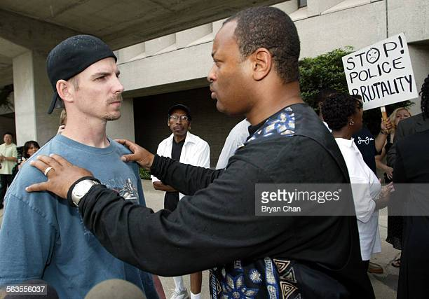 Amateur videographer Mitchell Crooks left and Najee Ali talk following a news conference where they called on District Attorney Steve Cooley to...