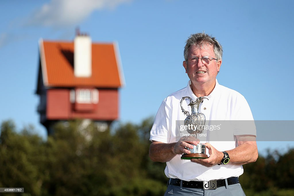 Amateur Winner John Griffin poses with the trophy after day two of the PGA Super 60's Tournament at Thorpeness Hotel and Golf Club on August 15, 2014 in Thorpeness, England.
