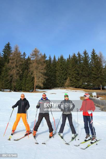 Amateur Winter Sports  alpine skiing. Group of skiers. Best friends men and women, snow skiers  enjoying on sunny ski resorts.  High mountain snowy landscape.  Kronplatz, mountain of the Dolomites in South Tyrol, Italy.
