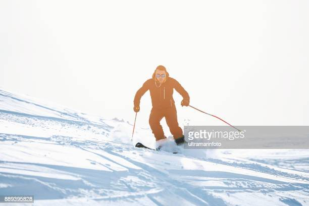 Amateur Winter Sports  alpine skiing. Men , snow skiers, enjoying on sunny ski resorts.  High mountain snowy landscape. Cortina d'Ampezzo mountain range, Alps. It is located in the Italiy.