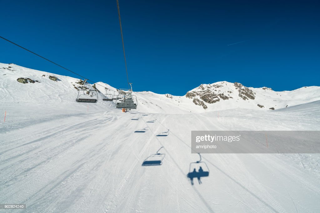 empty chair lift summer amateur winter sports going up on chair lift over empty ski piste stock photo going up on chair lift over empty ski piste