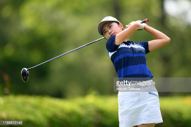Amateur Yuka Yasuda of Japan hits her tee shot on the 13th hole during the first round of the Ai Miyazato Suntory Ladies Open Golf Tournament at...