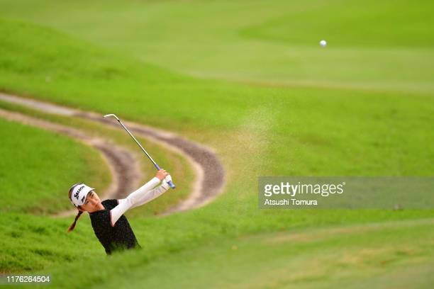 Amateur Yuka Yasuda of Japan hits out from a bunker to make a chipin eagle on the 15th hole during the final round of the Descente Ladies Tokai...