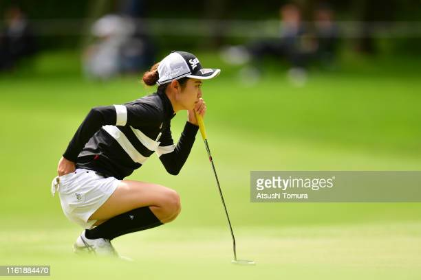 Amateur Yuka Yasuda of Japan lines up a putt on the 15th green during the final round of the Nippon Ham Ladies Classic at Katsura Golf Club on July...