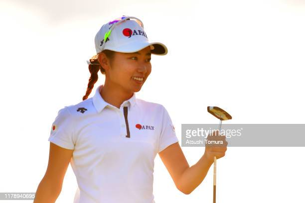 Amateur Yuka Yasuda of Japan smiles after holing out with the birdie on the 18th green during the second round of the Japan Women's Open Championship...