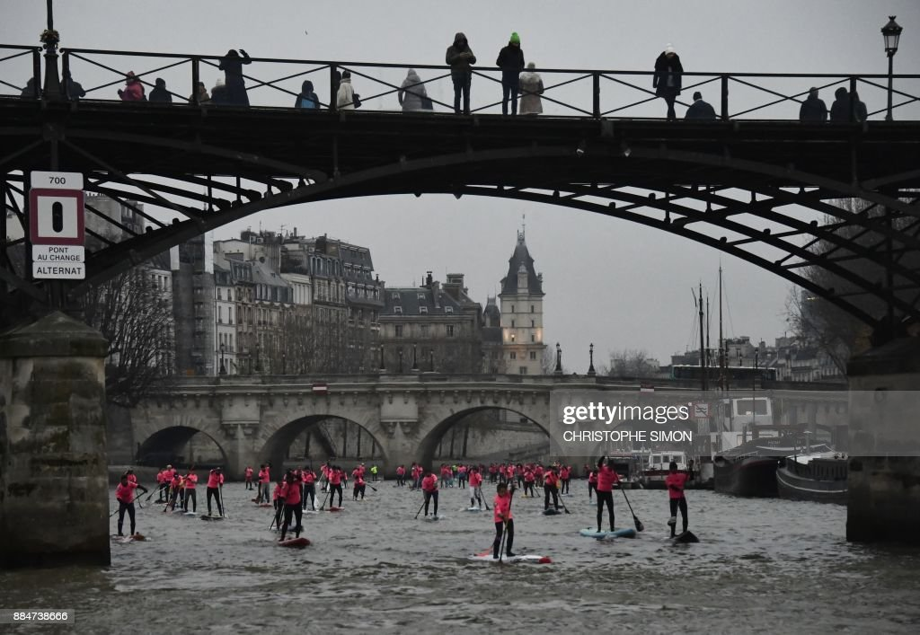 Amateurs And Professionals Take Part In The Nautic Sup Paris Crossing Stand Up Paddle Race Along The Seine River In Paris On December 3 2017