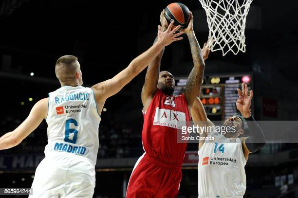 Amath M'Baye #24 forward of AX Armani Exchange Olimpia Milan and Gustavo Ayon #14 center of Real Madrid and Dino Radoncic #6 forward of Real Madrid...