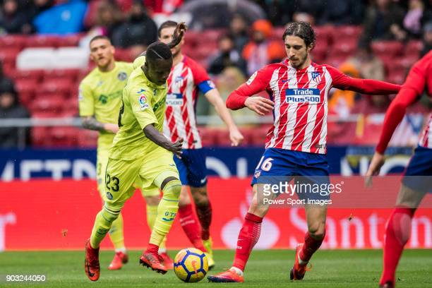 Amath Ndiaye Diedhiou of Getafe CF competes for the ball with Sime Vrsaljko of Atletico de Madrid during the La Liga 201718 match between Atletico de...