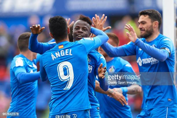 Amath Ndiaye of Getafe celebrates after scoring his team's first goal with his teammates during the La Liga match between Getafe and Girona at...