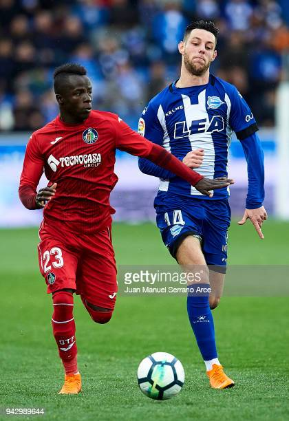Amath Ndiaye of Getafe CF duels for the ball with Jorge Franco 'Burgui' of Deportivo Alaves during the La Liga match between Deportivo Alaves and...