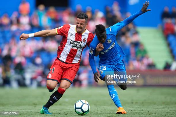 Amath Ndiaye of Getafe competes for the ball with Aday Benitez of Girona during the La Liga match between Getafe and Girona at Coliseum Alfonso Perez...