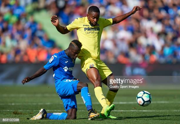 Amath Ndiaye of Getafe competes for the ball with Cedric Bakambu of Villarreal during the La Liga match between Getafe and Villarreal at Coliseum...
