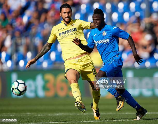 Amath Ndiaye of Getafe competes for the ball with Roberto Soriano of Villarreal during the La Liga match between Getafe and Villarreal at Coliseum...