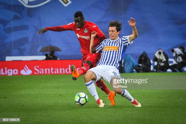 Amath of Getafe duels for the ball with Alvaro Odriozola of Real Sociedad during the Spanish league football match between Real Sociedad and Getafe...