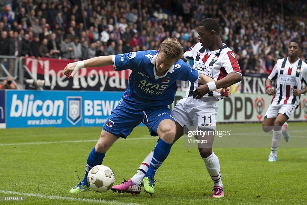 aMattias Johansson of AZ, Virgil Misidjan of Willem II, wGenero Snijders of Willem II during the Dutch Eredivisie match between Willem II and AZ Alkmaar on May 12, 2013 at the Koning Willem II stadium in Tilburg, The Netherlands.