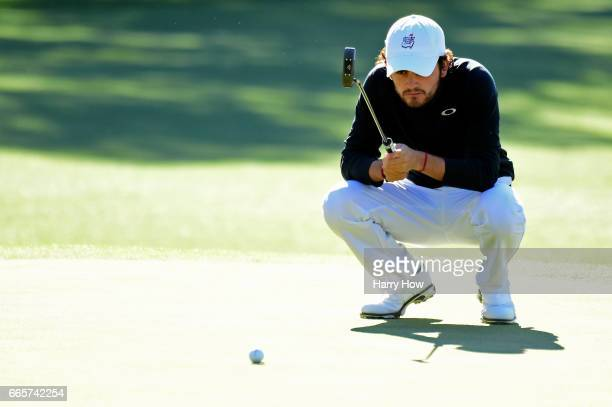 Amatuer Toto Gana of Chile lines up a putt on the first hole during the second round of the 2017 Masters Tournament at Augusta National Golf Club on...