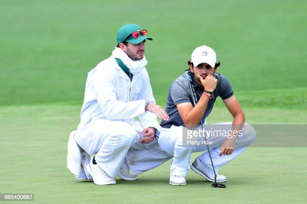 Amatuer Toto Gana of Chile lines up a putt on the second hole during the first round of the 2017 Masters Tournament at Augusta National Golf Club on...