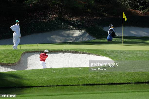 Amatuer Toto Gana of Chile plays a shot from a bunker during a practice round prior to the start of the 2017 Masters Tournament at Augusta National...