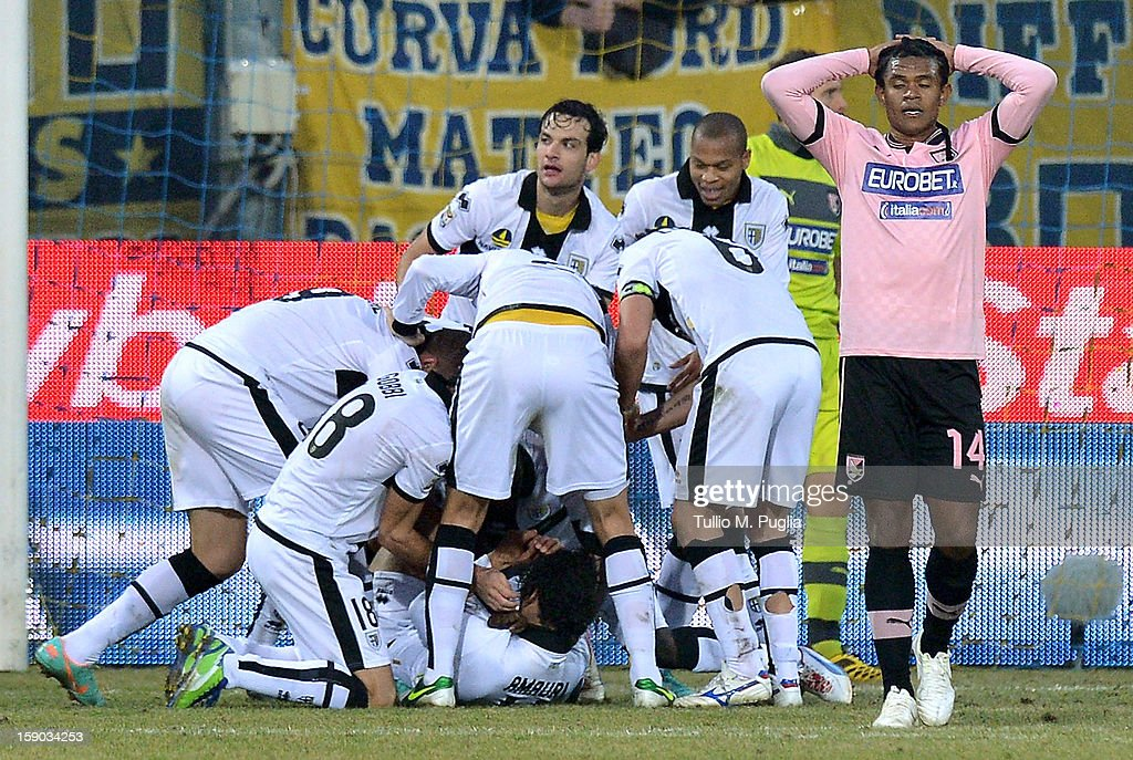 Amauri Carvalho de Oliveira (C, bottom) of Parma celebrates with team mates after scoring his team's second goal during the Serie A match between Parma FC and US Citta di Palermo at Stadio Ennio Tardini on January 6, 2013 in Parma, Italy.