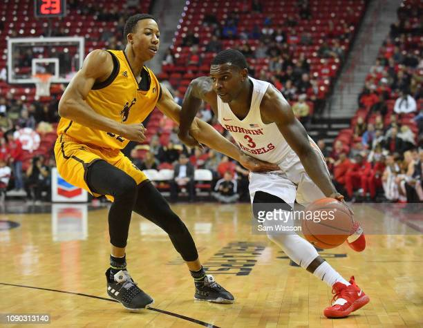 Amauri Hardy of the UNLV Rebels drives against Brandon Porter of the Wyoming Cowboys during their game at the Thomas Mack Center on January 05 2019...