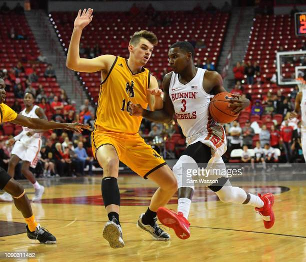 Amauri Hardy of the UNLV Rebels drives against Hunter Thompson of the Wyoming Cowboys during their game at the Thomas Mack Center on January 05 2019...