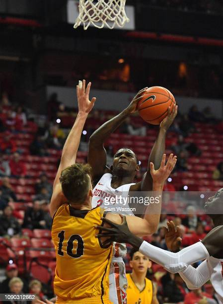 Amauri Hardy of the UNLV Rebels shoots against Hunter Thompson of the Wyoming Cowboys during their game at the Thomas Mack Center on January 05 2019...
