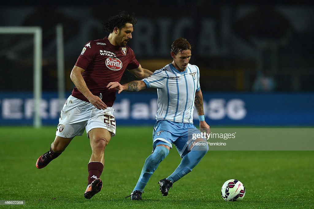 Amauri (L) of Torino FC competes with Lucas Biglia of SS Lazio during the Serie A match between Torino FC and SS Lazio at Stadio Olimpico di Torino on March 16, 2015 in Turin, Italy.