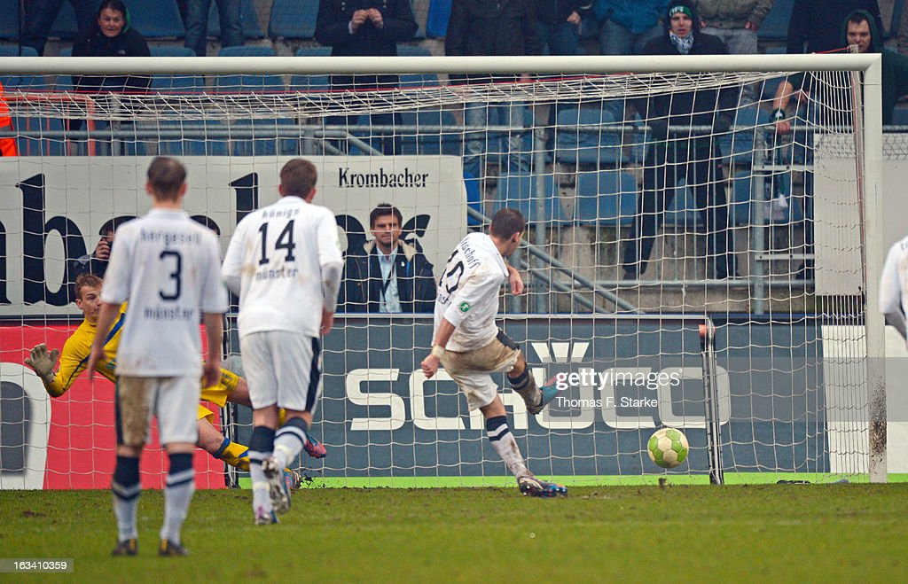 Amaury Bischoff (R) of Muenster scores a penalty against Patrick Platins (L) of Bielefeld during the Third League match between Arminia Bielefeld and Preussen Muenster at Schueco Arena on March 9, 2013 in Bielefeld, Germany.