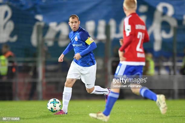 Amaury Bischoffof Hansa Rostock plays the ball during the 3. Liga match between SpVgg Unterhaching and F.C. Hansa Rostock at Alpenbauer Sportpark on...