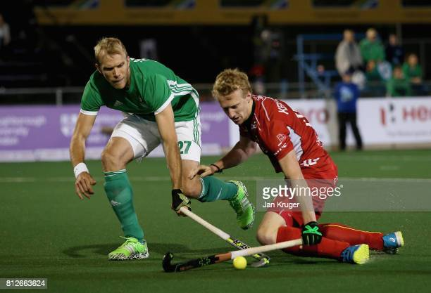 Amaury Keusters of Belgium and Conor Harte of Ireland battle for possession during day 2 of the FIH Hockey World League Semi Finals Pool B match...