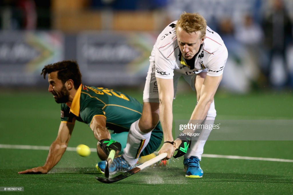 Amaury Keusters of Belgium shoots as Jethro Eustice of South Africa attempts to block during the Group B match between South Africa and Belgium on day five of the FIH Hockey World League - Men's Semi Finals on July 17, 2017 in Johannesburg, South Africa.