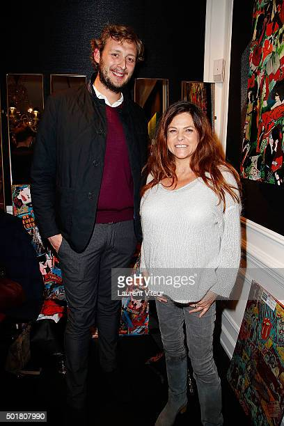 Amaury Levaux and Charlotte Valandrey attend 'Accords Croises' Anne Mondy's exhibition at Rue Bonaparte on December 17 2015 in Paris France