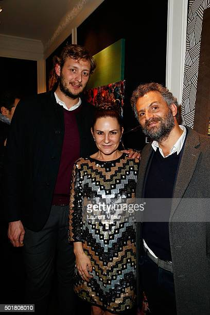 Amaury Levaux Anne Mondy and Actor Patrick Mimoun attend 'Accords Croises' Anne Mondy's exhibition at Rue Bonaparte on December 17 2015 in Paris...