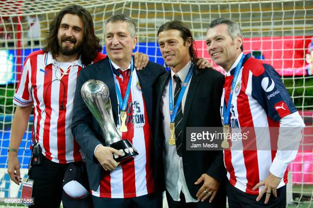 Amaury Vergara Jorge Vergara Matias Almeyda and Jose Luis Higuera pose with the champions trophy after winning the Final second leg match between...