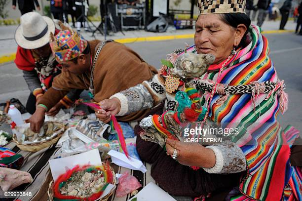 Amautas Aymara priests hold a traitional ritual to acknowledge Pachamama before the departure of the reed macehandmade 18meter long raft Viracocha...